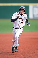 Pavin Smith (10) of the Virginia Cavaliers hustles towards third base against the Hartford Hawks at The Ripken Experience on February 27, 2015 in Myrtle Beach, South Carolina.  The Cavaliers defeated the Hawks 5-1.  (Brian Westerholt/Four Seam Images)