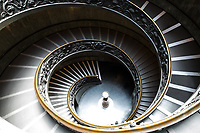 Legendary spiral staircase design in the interior of the modern Bramante Staircase in the Pio-Clementine Museum, Vatican Rome Italy, Southern Europe