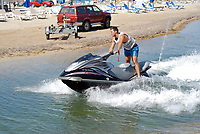 Young man riding a waterbike in Ibiza, Spain