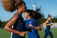 KASHIMA, JAPAN - AUGUST 4: Christen Press #11 of the USWNT warms up during a training session at the practice field on August 4, 2021 in Kashima, Japan.