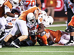 Oklahoma State Cowboys running back Kendall Hunter (24) struggles for a few more yards as Texas Longhorns safety Blake Gideon (21) tries to stop him during the game between the Oklahoma State Cowboys and the University of Texas in Austin Texas Longhorns at the Daryl K. Royal- Texas Memorial Stadium in Austin, Texas. The Oklahoma State Cowboys defeated the Texas Longhorns 33 to 16.