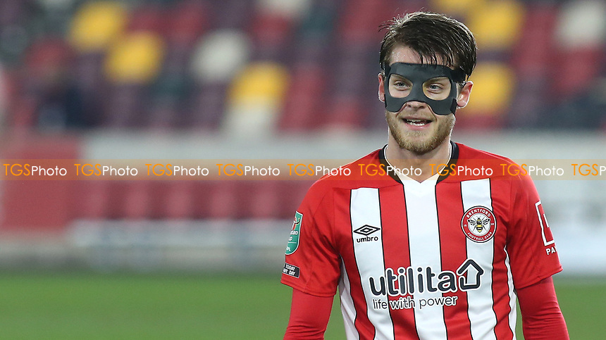 Matheus Jensen of Brentford played in a protective mask during Brentford vs Newcastle United, Carabao Cup Football at the Brentford Community Stadium on 22nd December 2020