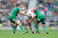 Joe Marler of Harlequins is tackled by David Paice and former team mate Tom Guest of London Irish during the Premiership Rugby Round 1 match between London Irish and Harlequins at Twickenham Stadium on Saturday 6th September 2014 (Photo by Rob Munro)