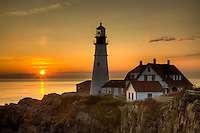 The first rays of sun after sunrise reach the Portland Head Light, built in 1791, which protects mariners entering Casco Bay.  The lighthouse is located in Fort Williams Park, Cape Elizabeth, Maine.