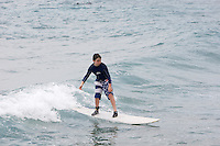 Josh, young boy learning to surf at Surfers Point , Inch Marlow ..Barbados , Easter 2010 ..pic copyright Steve Behr / Stockfile