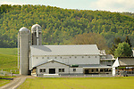 White barn and silo in Spring. Kishacoquillas Valley, Route 655, PA.