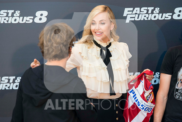 """South African actress Charlize Theron with Atletico de Madrid's player Antoine Griezmann  during the presentation of the film """"Fast & Furious 8"""" at Hotel Villa Magna in Madrid, April 06, 2017. Spain.<br /> (ALTERPHOTOS/BorjaB.Hojas)"""