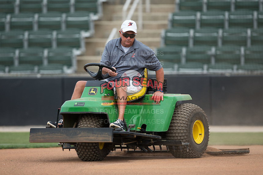 Kannapolis Intimidators head grounds keeper Billy Ball gets the field ready for the South Atlantic League game between the Asheville Tourists and the Kannapolis Intimidators at Intimidators Stadium on May 28, 2016 in Kannapolis, North Carolina.  The Intimidators defeated the Tourists 5-4 in 10 innings.  (Brian Westerholt/Four Seam Images)