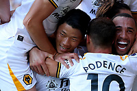 11th September 2021; Vicarge Road, Watford, Herts,  England;  Premier League football, Watford versus Wolverhampton Wanderers; Hwang Hee-chan of Wolverhampton Wanderers celebrates his goal with team mates for 0-2