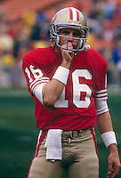 SAN FRANCISCO, CA - Joe Montana of the San Francisco 49ers on the sidelines before a game at Candlestick Park in San Francisco, California in 1987.  Photo by Brad Mangin