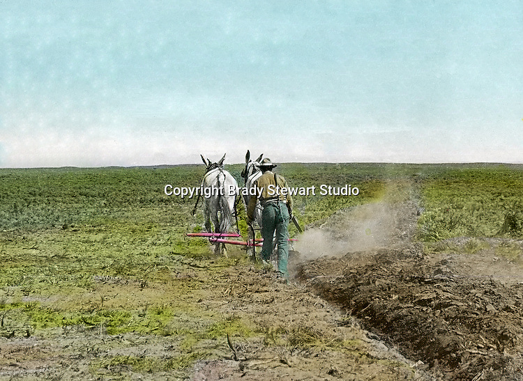 Jerome ID:  Plowing the farmland on the 160-acre homestead. Brady Stewart and three friends went to Idaho on a lark from 1909 thru early 1912.  As part of the Mondell Homestead Act, they received a grant of 160 acres north of the Snake River.  Brady Stewart photographed the adventures of farming along with the spectacular landscapes. To give family and friends a better feel for the adventure, he hand-color black and white negatives into full-color 3x4 lantern slides.  The Process:  He contacted a negative with another negative to create a positive slide.  He then selected a fine brush and colors and meticulously created full-color slides.