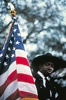 African-American man on horseback w  American flag. man on horseback w, American flag. New Orleans Louisiana, Uptown, Mardi Gras parade.