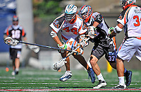 23 August 2008: Los Angeles Riptide Defenseman Greg Bice (44) maintains possession while being checked by Denver Outlaws' Midfielder Benson Erwin (37) during the Semi-Finals of the Major League Lacrosse Championship Weekend at Harvard Stadium in Boston, MA. The Outlaws edged out the Riptide 13-12, advancing to the upcoming Championship Game.. .Mandatory Photo Credit: Ed Wolfstein Photo