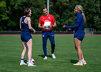 CLEVELAND, OH - SEPTEMBER 14: Vlatko Andonovski of the United States talks with Rose Lavelle and Lindsey Horan after a training session at the training fields on September 14, 2021 in Cleveland, Ohio.