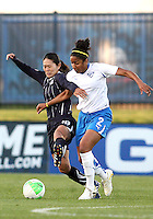 Homare Sawa#10 of the Washington Freedom battles with Chioma Igwe#2 of the Boston Breakers during a WPS match on April 10 2010, at the Maryland Soccerplex, in Boyds, Maryland. Breakers won 2-1.