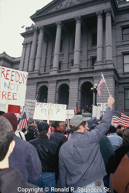 PEOPLE CARRY SIGNS AT PRO IRAQ WAR RALLY IN DENVER