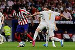 Thomas Teye of Atletico de Madrid and Eden Hazard of Real Madrid during La Liga match between Atletico de Madrid and Real Madrid at Wanda Metropolitano Stadium{ in Madrid, Spain. {iptcmonthname} 28, 2019. (ALTERPHOTOS/A. Perez Meca)