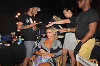 MIAMI BEACH, FLORIDA - JULY 13: Models backstage at Sinesia Karol at The Paraiso Tent on July 13, 2019 in Miami Beach, Florida.<br />