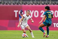 KASHIMA, JAPAN - JULY 27: Kelley O'Hara #5 of the United States and Mary Fowler #11 of Australia battle for the ball during a game between Australia and USWNT at Ibaraki Kashima Stadium on July 27, 2021 in Kashima, Japan.