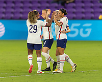 ORLANDO, FL - JANUARY 22: Megan Rapinoe #15 celebrates her goal with teammates during a game between Colombia and USWNT at Exploria stadium on January 22, 2021 in Orlando, Florida.