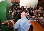 Coiner Ken Hopple, watches as Gov. Brian Sandoval mints the first medallion during a ceremony marking the beginning of production of the third medallion in the four-part Sesquicentennial series, at the Nevada State Museum in Carson City, Nev., on Friday, May 30, 2014. <br /> Photo by Cathleen Allison