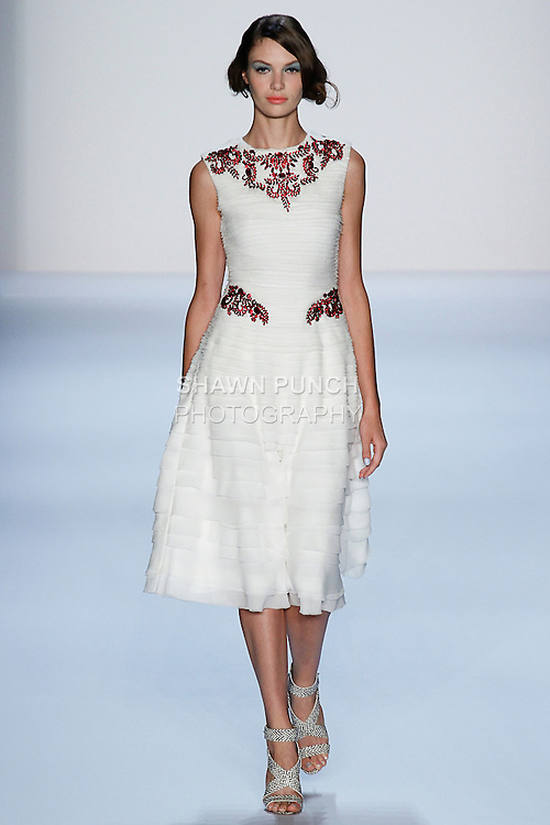 Model walks runway in a Badgley Mischka Spring 2014 outfit by Mark Badgley and James Mischka, during Mercedes Benz Fashion Week Spring 2014, on September 10, 2013.