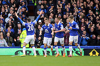 Pictured: Ross Barkley of Everton (L) is celebrating his goal with team mates. Saturday 22 March 2014<br /> Re: Barclay's Premier League, Everton v Swansea City FC at Goodison Park, Liverpool, UK.