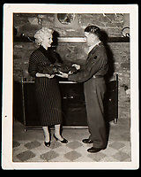 BNPS.co.uk (01202 558833)<br /> Pic: Julien'sAuctions/BNPS<br /> <br /> Marilyn Monroe recieves the jacket during her trip<br /> <br /> Marilyn Monroe's personalised army jacket and ID card have emerged for sale for £80,000. ($100,000)<br /> <br /> The starlet wore the green woollen jacket which is covered in army patches during her famous visit to entertain US troops in Korea in February 1954.<br /> <br /> The name 'Monroe' is in white stitching above the left pocket, and there are black and white photos of her posing in the long sleeved 'medium' sized jacket.<br /> <br /> Her 'Non Combatant's Certificate of Identity' card lists by her real name 'Norma Jeane DiMaggio' and there is a small photo of her in the top right hand corner of the laminated card, as well as her finger print.<br /> <br /> Monroe has signed it and a wealth of personal information is listed, including her date of birth, height, weight, hair colour and blood type. The items are being sold with Los Angeles based Julien's Auctions.