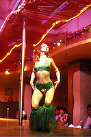 A woman dancer performs on stage at a night club in Guangzhou, China.