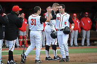 Rutgers University Scarlet Knights infielder Nick Favatella (5) celebrates a home run with team mate Tom Marcinczyk (31) during game game 1 of a double header against the University of Houston Cougers at Bainton Field on April 5, 2014 in Piscataway, New Jersey. Rutgers defeated Houston 7-3.      <br />  (Tomasso DeRosa/ Four Seam Images)