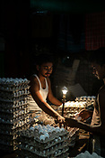 Wholesale egg merchants inspect eggs in their shop at the century-old Sir Stuart Hogg Market, also known as the New Market in Kolkata, West Bengal  on Friday, May 26, 2017. Photographer: Sanjit Das