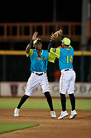 Bradenton Barbanegras shortstop Oneil Cruz (13) and second baseman Adrian Valerio (14) celebrate after closing out a Florida State League game against the St. Lucie Mets on July 27, 2019 at LECOM Park in Bradenton, Florida.  Bradenton defeated St. Lucie 3-2.  (Mike Janes/Four Seam Images)