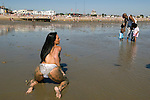 Topless amateur glamour model being photographed Southend on Sea Essex England  2000s