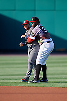Rochester Red Wings Kennys Vargas (30) hugs Lehigh Valley IronPigs Danny Ortiz (6) before a game against the Lehigh Valley IronPigs on June 29, 2018 at Frontier Field in Rochester, New York.  Lehigh Valley defeated Rochester 2-1.  (Mike Janes/Four Seam Images)