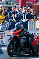 Oct 14, 2019; Concord, NC, USA; ROTC honor guard solider students look on as NHRA pro stock motorcycle rider Eddie Krawiec races during the Carolina Nationals at zMax Dragway. Mandatory Credit: Mark J. Rebilas-USA TODAY Sports