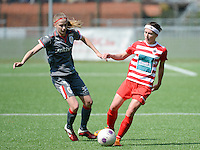 20140419 - ANTWERPEN , BELGIUM : Antwerp Stephanie Suenens (right) pictured with Standard's Julie Biesmans (left) during the soccer match between the women teams of RAFC Antwerp Ladies  and Standard Femina  , on the 24th matchday of the BeNeleague competition on Saturday 19 April 2014 in Deurne .  PHOTO DAVID CATRY