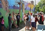 Mural artist Abner Rivera, left, talks with a group of Boys & Girls Club members during a tour of local murals in Carson City, Nev., on Monday, July 31, 2017. Mark Salinas, Carson City's art and culture coordinator and the Adams Hub sponsored the tour. <br />