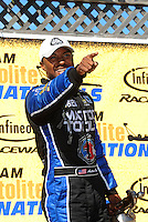 Jul. 31, 2011; Sonoma, CA, USA; NHRA top fuel dragster driver Antron Brown celebrates after winning the Fram Autolite Nationals at Infineon Raceway. Mandatory Credit: Mark J. Rebilas-