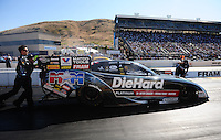Jul. 29, 2011; Sonoma, CA, USA; Crew members direct NHRA funny car driver Matt Hagan to the starting line during qualifying for the Fram Autolite Nationals at Infineon Raceway. Mandatory Credit: Mark J. Rebilas-