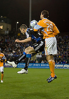 Cam Weaver(17) goes up for the ball against Geoff Cameron (20). San Jose Earthquakes defeated Houston Dynamo 3-2 at Buck Shaw Stadium in Santa Clara, California on March 28th, 2009.