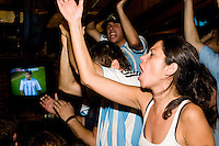 Argentina fans watch their team play Mexico in a World Cup match on June 24, 2006 at Novecento, a New York City restaurant...The World Cup, held every four years in different locales, is the world's pre-eminent sports tournament in the world's most popular sport, soccer (or football, as most of the world calls it).  Qualification for the World Cup is open to any country with a national team accredited by FIFA, world soccer's governing body. The first World Cup, organized by FIFA in response to the popularity of the first Olympic Games' soccer tournaments, was held in 1930 in Uruguay and was participated in by 13 nations.    ..As of 2010 there are 208 such teams.  The final field of the World Cup is narrowed down to 32 national teams in the three years preceding the tournament, with each region of the world allotted a specific number of spots.  ..The World Cup is the most widely regularly watched event in the world, with soccer teams being a source of national pride.  In most nations, the whole country is at a standstill when their team is playing in the tournament, everyone's eyes glued to their televisions or their ears to the radio, to see if their team will prevail.  While the United States in general is a conspicuous exception to the grip of World Cup fever there is one city that is a rather large exception to that rule.  In New York City, the most diverse city in a nation of immigrants, the melting pot that is America is on full display as fans of all nations gather in all possible venues to watch their teams and celebrate where they have come from. .