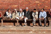 Nepal, Patan.  Bench Full of Nepalese Men Talking, Late Afternoon, Durbar Square.