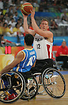 Patrick Anderson (12) of Vancouver gets around Hussein Haidari of Sweden from Sweden in men's wheelchair basketball action at the Paralympic Games in Beijing,Tuesday, Sept., 9, 2008.    Photo by Mike Ridewood/CPC