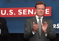 Democratic Senate hopeful Jim Webb claps his hands while being introduced to a large crowd of supporters during a rally held Monday October 30, 2006 on campus at the University of Virginia in Charlottesville, Va.