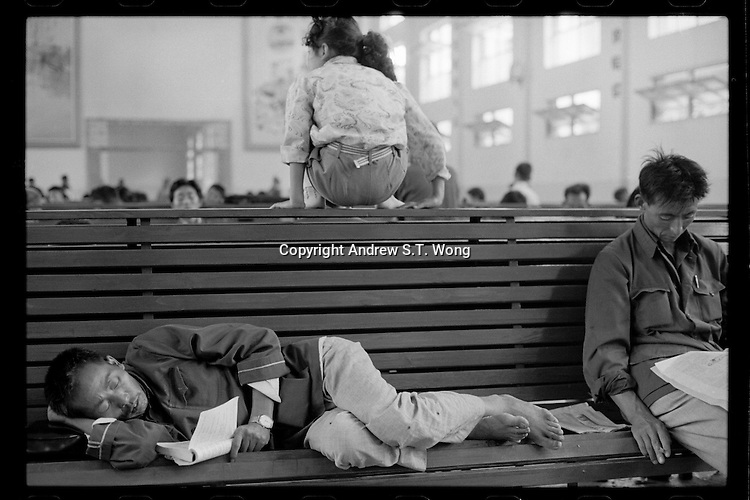 Chinese travellers wait at a long distance bus terminus in Jiangdu, Jiangsu province, China, 1983.