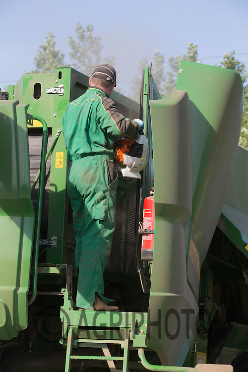 Using a leaf blower to remove harvest dust from a combine <br /> Picture Tim Scrivener 07850 303986<br /> ….Covering agriculture in the UK….