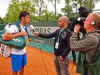 France, Paris, 27.05.2014. Tennis, French Open,Roland Garros, Robin Haase (NED) being interviews by Dutch television NOS<br /> Photo:Tennisimages/Henk Koster