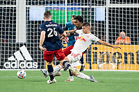 FOXBOROUGH, MA - MAY 22: Patryk Klimala #10 of New York Red Bulls passes the ball under pressure from Tommy McNamara #26 of New England Revolution and Jon Bell #22 of New England Revolution during a game between New York Red Bulls and New England Revolution at Gillette Stadium on May 22, 2021 in Foxborough, Massachusetts.