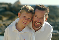 Portrait of father and son at the beach while on vacation on Hawaii