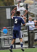 HYATTSVILLE, MD - OCTOBER 26, 2012:  Julian Dove (17) of DeMatha Catholic High School leaps up over Camyer Matini (5) of St. Albans during a match at Heurich Field in Hyattsville, MD. on October 26. DeMatha won 2-0.